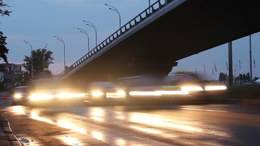 Cars timelapse, city road junction bridge, street light turn on