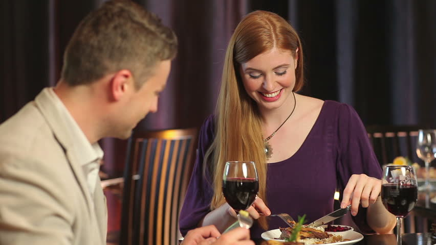 Attractive couple dining together in a classy restaurant