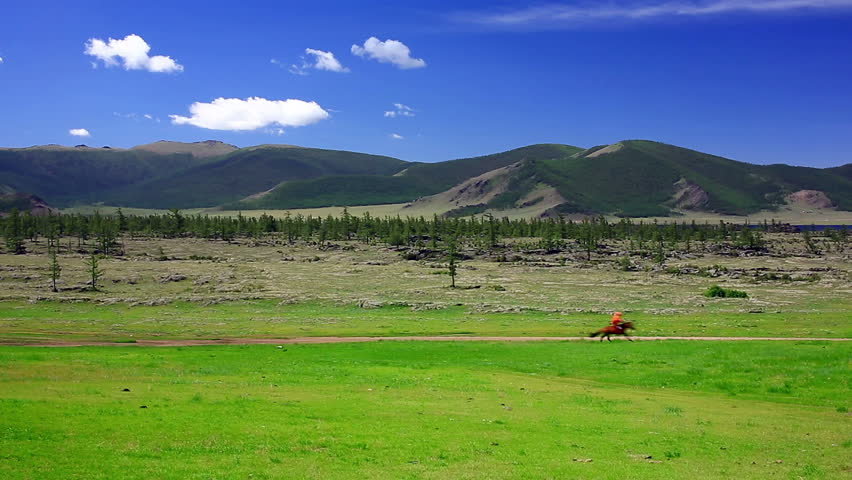 Man riding horse in Mongolian landscape, near Terkhiin Tsagaan Lake, Central Mongolia #5065727