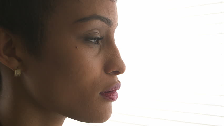Close up of African American business woman thinking and looking out window