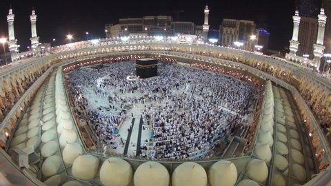 MAKKAH, SAUDI ARABIA- CIRCA APRIL 2012 : Muslim pilgrims circumambulate Kaaba at Masjidil Haram circa April 2012 in Makkah, S. Arabia. Muslims all around the world face the Kaaba during prayer time.
