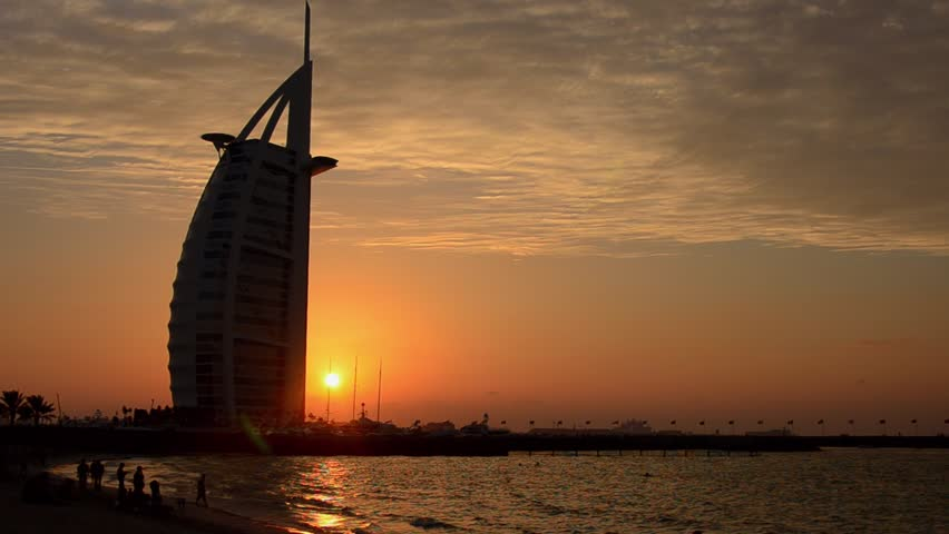 Dubai, United Arab Emirates - 7/23/13 - Worlds only 7 star hotel in Dubai UAE called the Burj Al Arab at sunset with luxury and water in United Arab Emirates