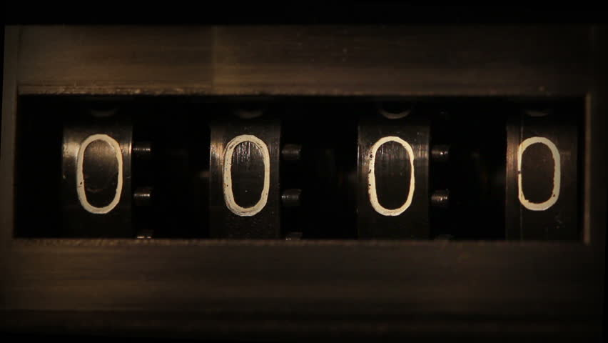 Old mechanical counter quickly counts numbers - macro | Shutterstock HD Video #5100656