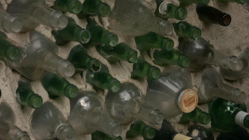a tilt of a wall made of bottles.