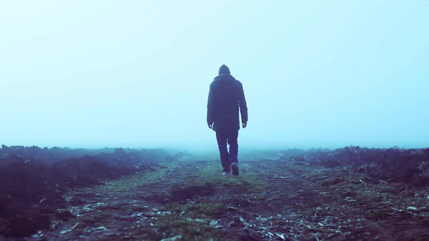 A lonely man walking into a foggy field in slow motion. | Shutterstock HD Video #5128394