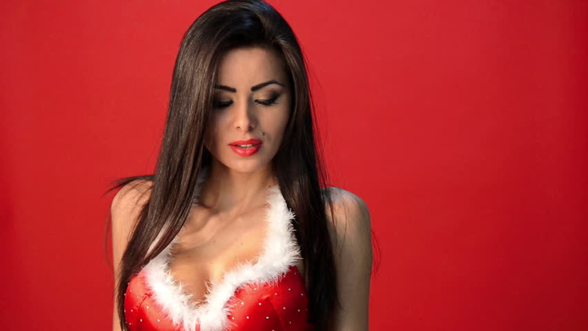 Sexy Brunette Woman In Red Christmas Outfit Posing Isolated And Sending Kisses Hd Stock Video