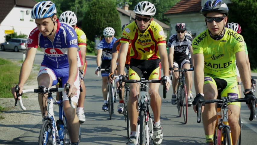 VRHNIKA, SLOVENIA - AUG 24, 2013: Leading pack of cyclists driving in synchronized fashion | Shutterstock HD Video #5137667