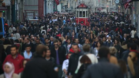 ISTANBUL - 09 November 2013  famous istiklal street Istanbul Turkey, time lapse tram and crowded people at istiklal avenue