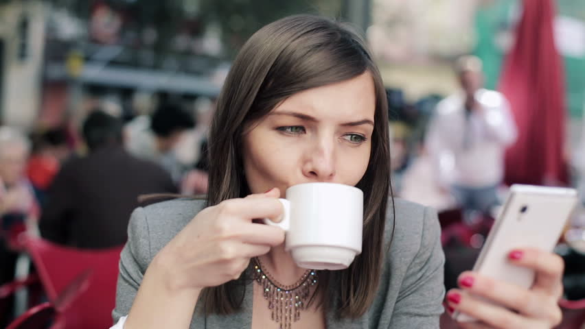 Businesswoman with smartphone drinking coffee in cafe  | Shutterstock HD Video #5172776