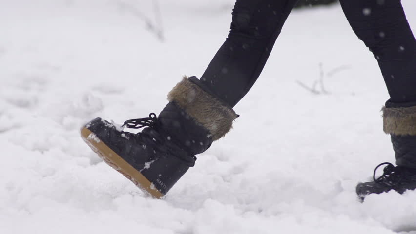 Slow Motion Of Black Female Snow Boots Walking Through Fresh Snow ...