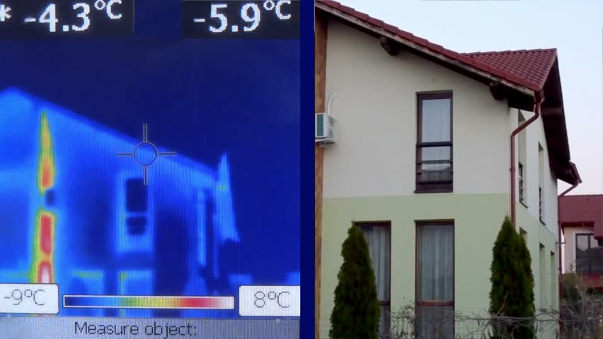 Thermovision Infrared camera inspecting the heat loss from a building