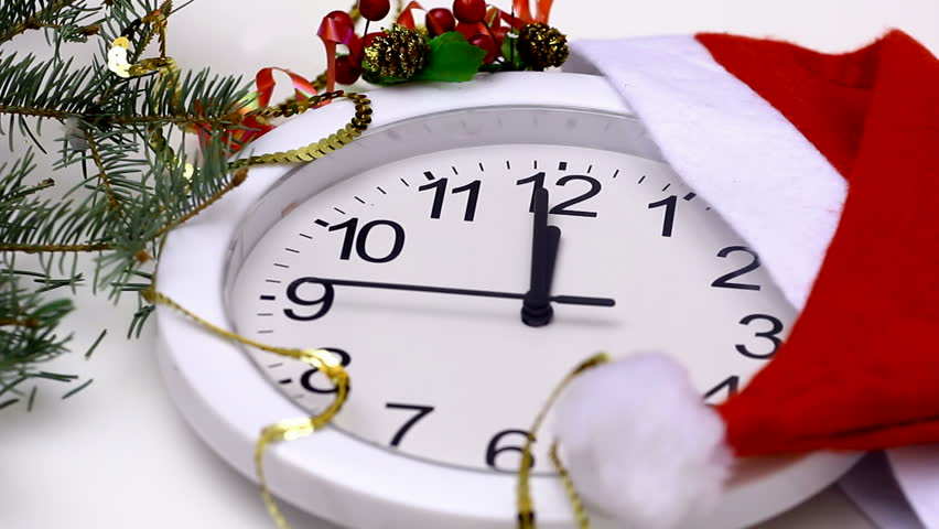 New Year clock ; Counting down the last 15 seconds to the New year on a mechanical clock decorated with a Santa's hat, video clip