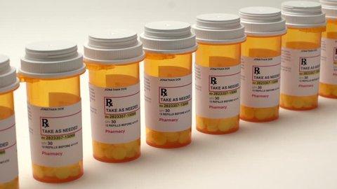 slider shot of medication bottles in a row