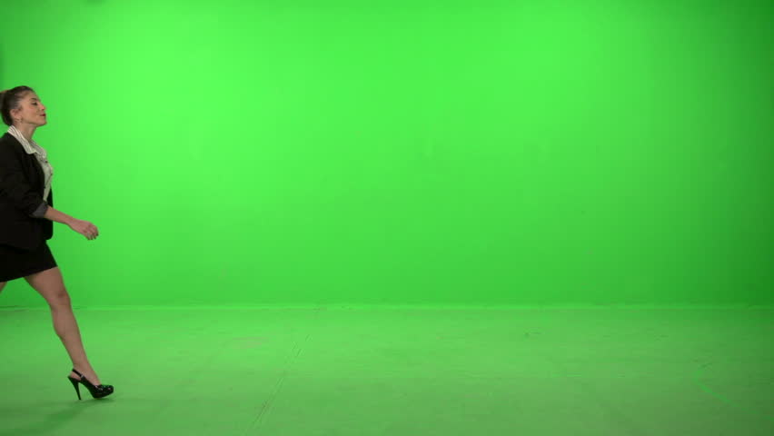 4c64e911d27 Dancer dressed as business woman falling on a green screen backround
