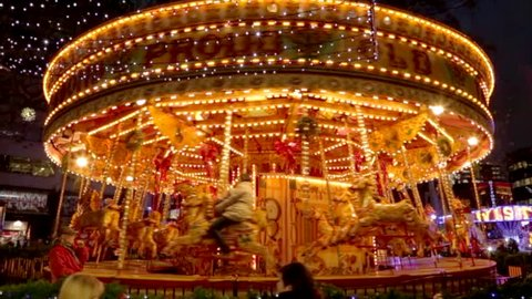 Horses Carousel in motion, in an amusement park.