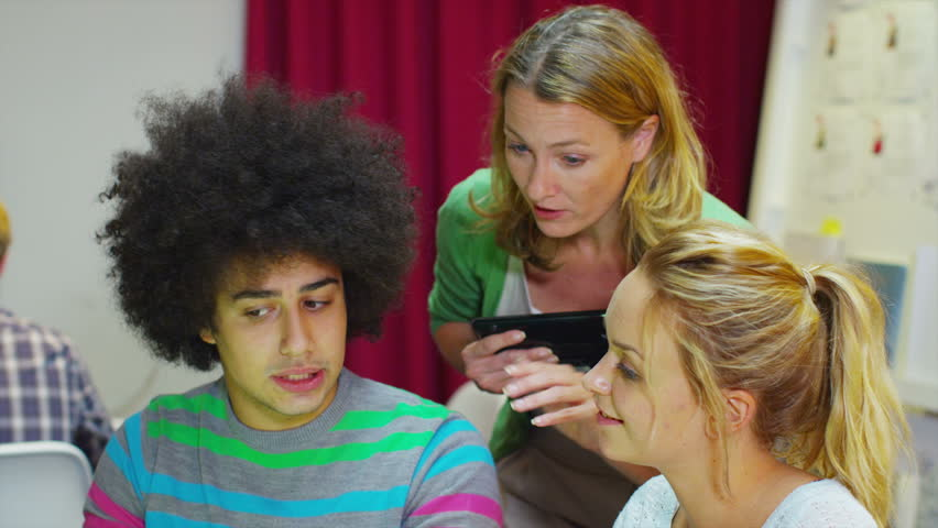 Young casual business group working together or students being taught by a teacher at adult education center. In slow motion. | Shutterstock HD Video #5254487