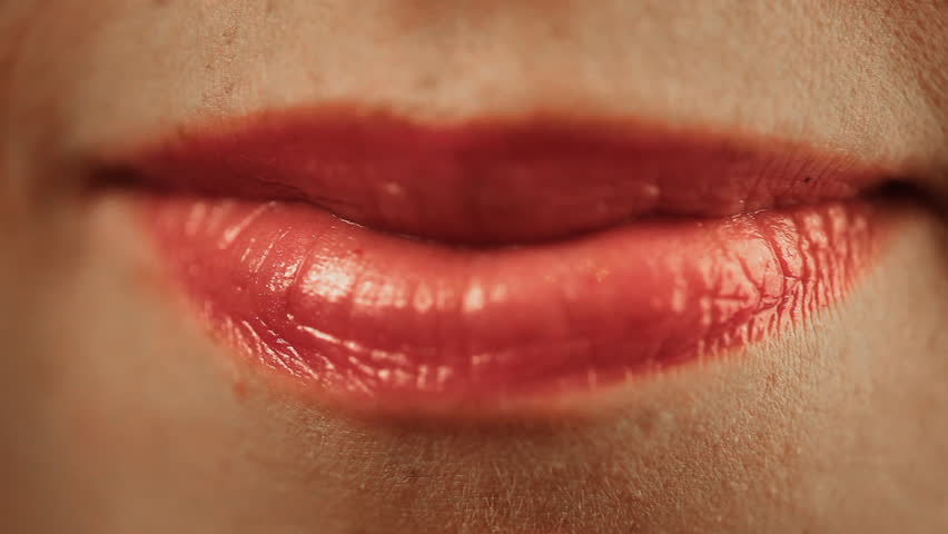 Sensual red lips of young woman