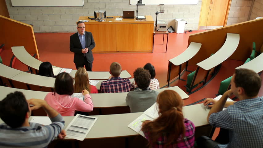 Lecturer speaking to his class in the lecture hall at the university | Shutterstock HD Video #5276546