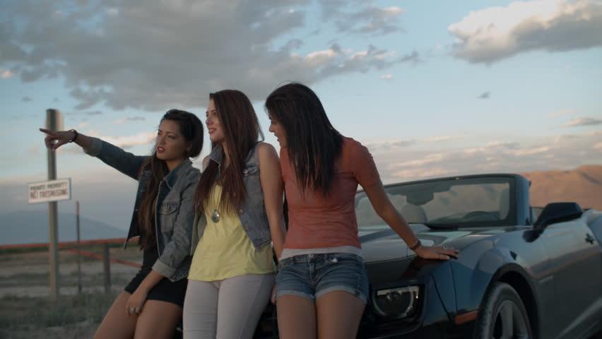 Three Beautiful Multi-Ethnic Teenage Girls Enjoying A Desert Sunset