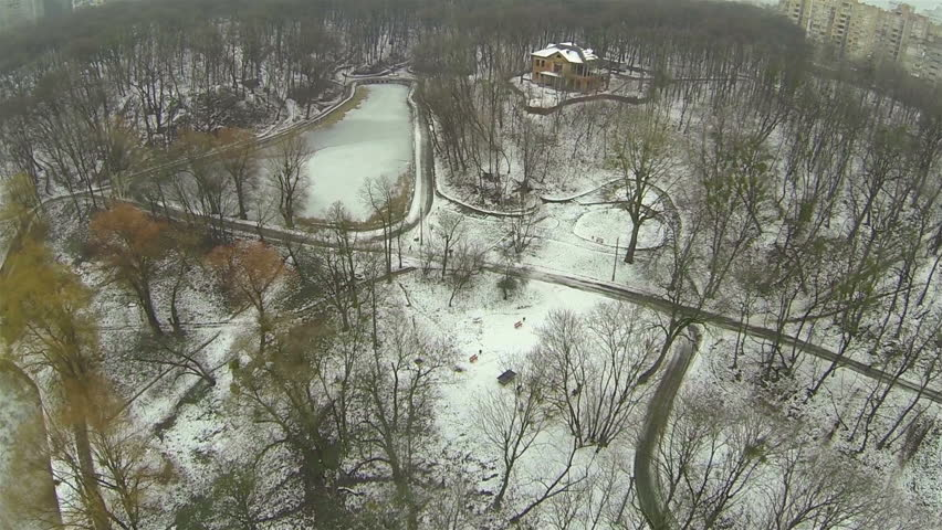 Flight over winter  lake. Top aerial