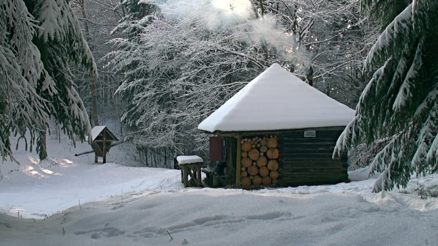 Picture Idyllic cottage in snow on the mountain forests