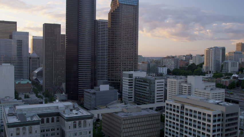 Aerial Skyscraper view at sunset with sun flare Columbia Center modern skyscraper Highway 5 Seattle, Pacific Seaport, Washington State, Pacific Northwest, USA, RED EPIC, 4K, UHD, Ultra HD resolution   Shutterstock HD Video #5300489