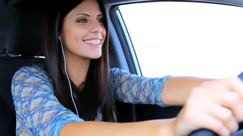 Happy woman on the phone driving car