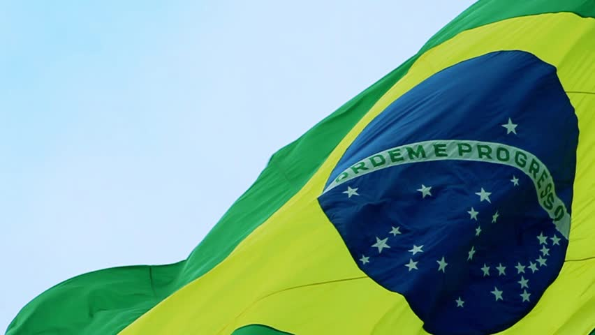 Real Brazil flag waving in the wind in slow motion. The Brazilian flag is a national symbol of this 5-times soccer Worldcup country going through Elections in 2018.