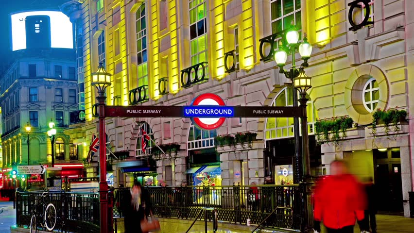Amazing London Piccadilly circus underground sign HD hyper time lapse. Timelapse movie of the bright lights of Piccadilly Circus in London, at night, wide angle