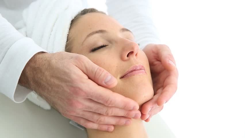 Woman relaxing in spa institute with massage