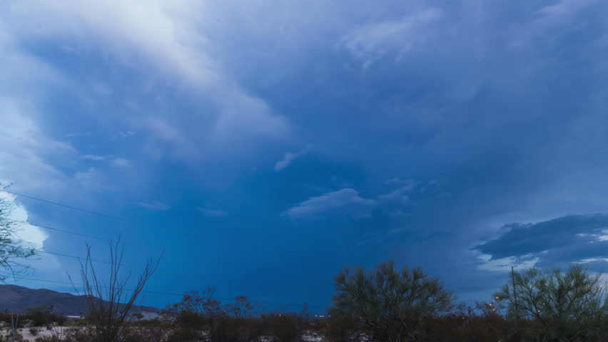 Evil looking desert monsoon storm build at dusk time lapse 1