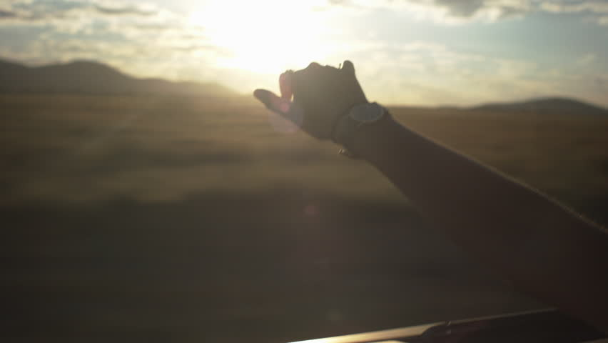 Teen Waves Her Hand In The Wind In A Convertible | Shutterstock Video #5364641
