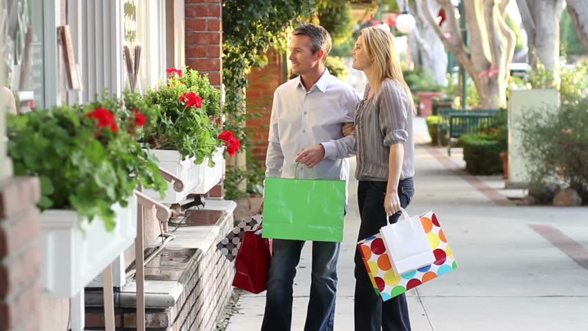 Couple window shopping. Professional models shot in December, 2011 in Glendora, California.