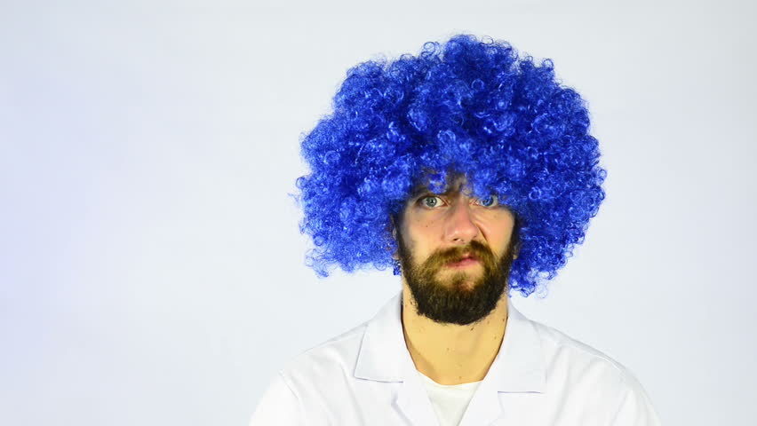 Crazy looking man in a blue wig looking at an interactive whiteboard  showing a networking diagram. ca2d7f8c8