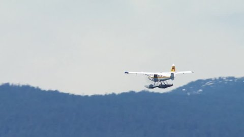 Sea plane flying over mountains in Vancouver, British Columbia.