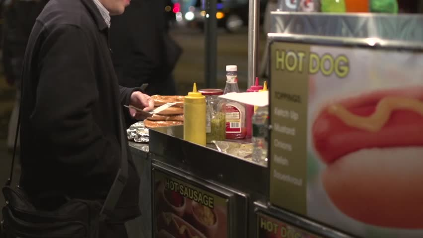 Eating at a New York City food stand (7 of 10) | Shutterstock HD Video #5382890