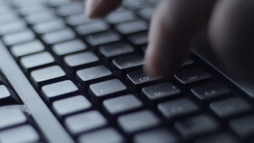 Man typing on black computer keyboard, tracking | Shutterstock HD Video #5385476