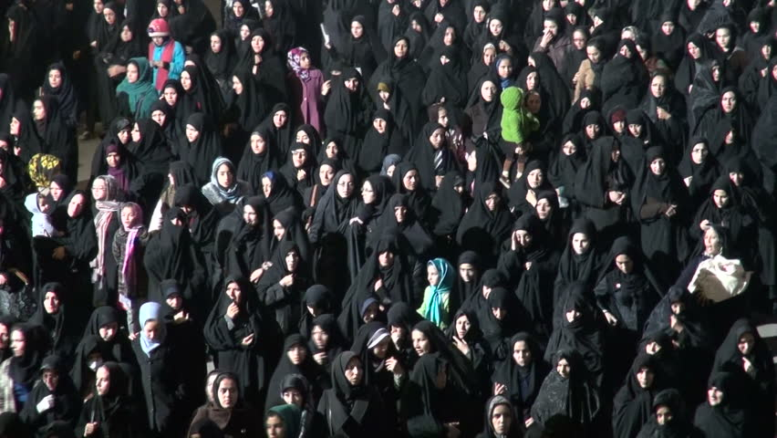 ZANJAN, IRAN - 15 NOVEMBER 2013: Veiled women in traditional black chadors are walking through the streets of Zanjan, to take part in a ceremony to commemorate the Battle of Karbala