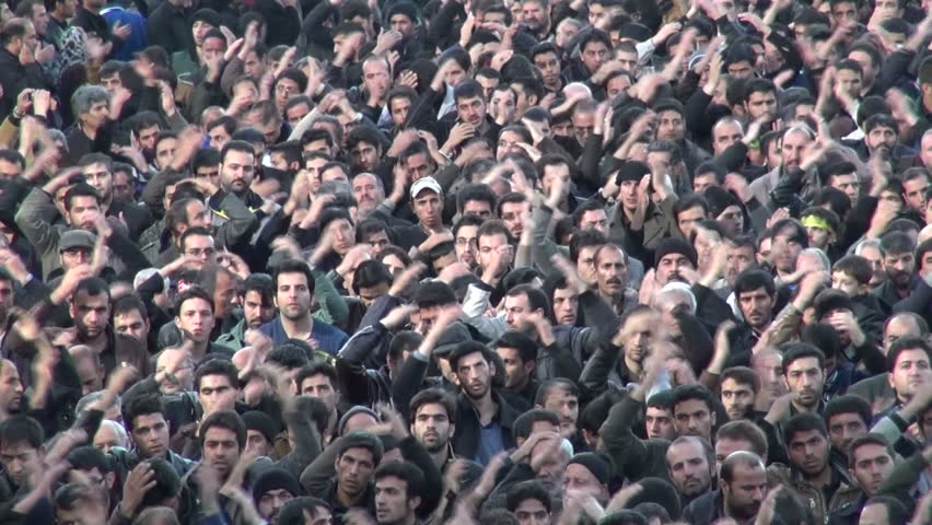 ZANJAN, IRAN - 15 NOVEMBER 2013: Crowds of men are touching their head to symbolize the suffering of Hussain, who was killed in Karbala, a main event in Shia Islam, in the streets of Zanjan, Iran | Shutterstock HD Video #5388026