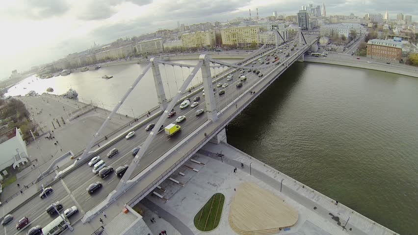Traffic on Crimean bridge and people walk by art market on quay near House of Painters in Moscow | Shutterstock HD Video #5394044