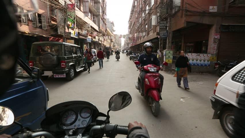 KATHMANDU, NEPAL - DEC 19: A trip on a motorcycle through the historical centre of the city, Dec 19, 2013 in Kathmandu, Nepal.