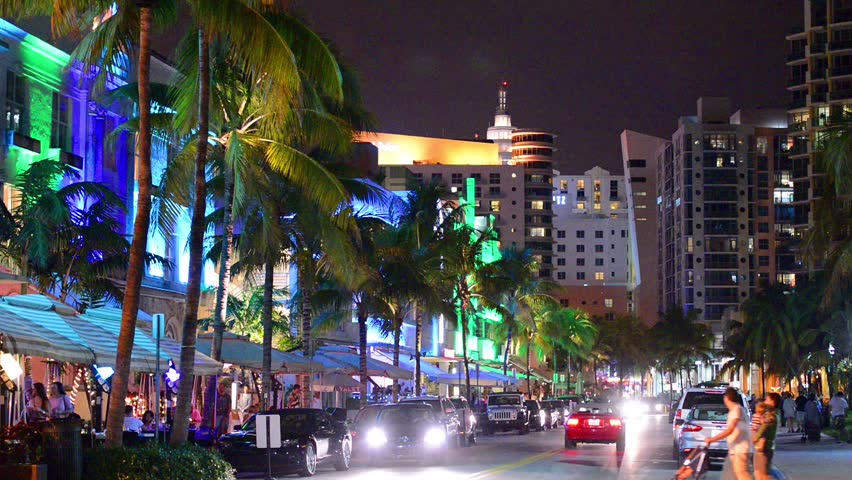 MIAMI, FLORIDA - JANUARY 6, 2014: Palm trees line Ocean Drive. The
