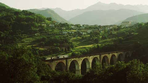 Train going through the Railway Bridge at beautiful Mountain Landscape.Shot on RED Digital Cinema Camera in 4K,so you can easily crop, rotate and zoom, without losing quality!