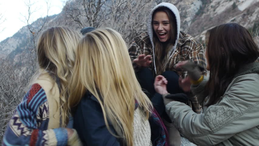 Two Teen Girls Ambushing Friends During An Outdoor Portrait