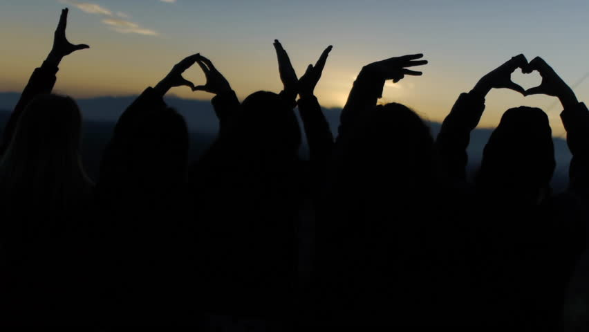Silhouetted Fingers Spell Love & Form A Heart Against A Tranquil Sunset