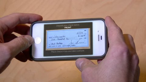 Depositing a check with a mobile phone. Check and phone interface are both fictional.