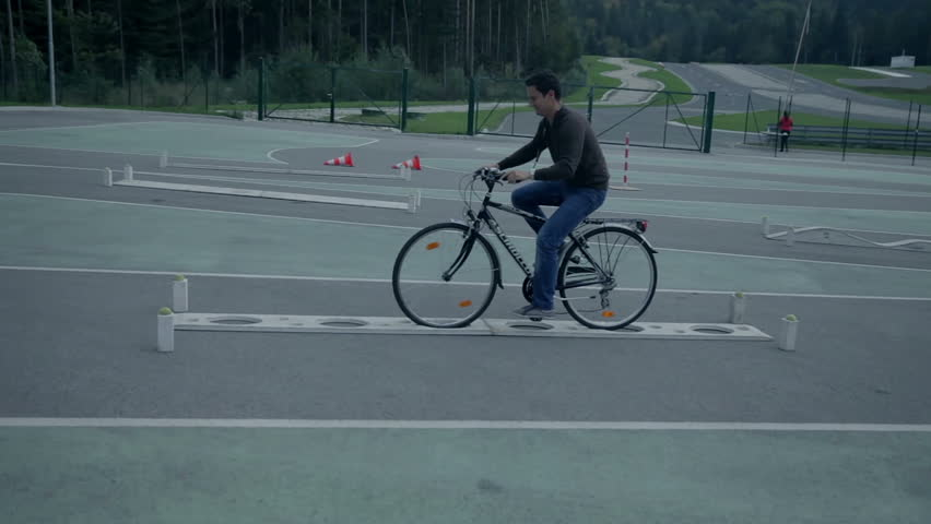 VRANSKO, SLOVENIA - SEP 2013: Driving a bike through various road obstacles. Go-cart and cars simulations event. | Shutterstock HD Video #5465918