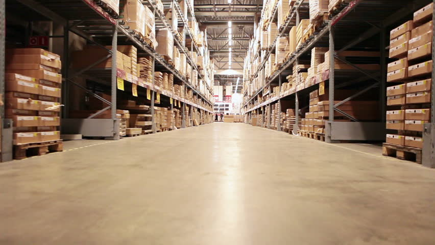 Camera moving between palettes with ordered goods and materials at warehouse #5483243