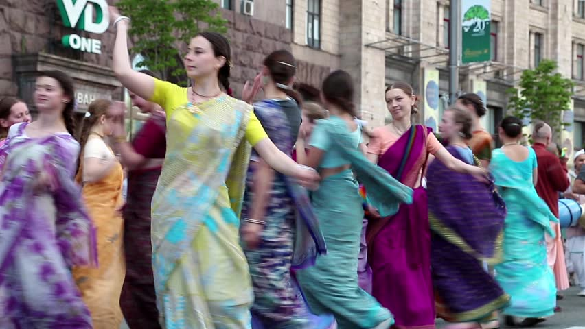 UKRAINE, KIEV, MAY 25, 2013: Women in Hindu traditional colorful costumes dancing and singing Hare Krishna mantra on the main street of Kiev, Ukraine, May 25, 2013