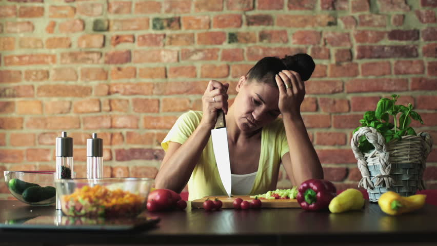 Bored woman preparing vegetable salad    Shutterstock HD Video #5488424